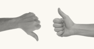 hand with a thumbs up and a thumbs down