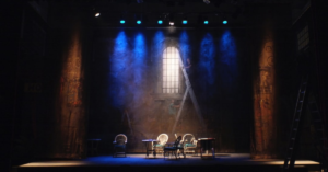 picture of a theatre stage with empty chairs