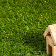 small wooden house sitting in grass